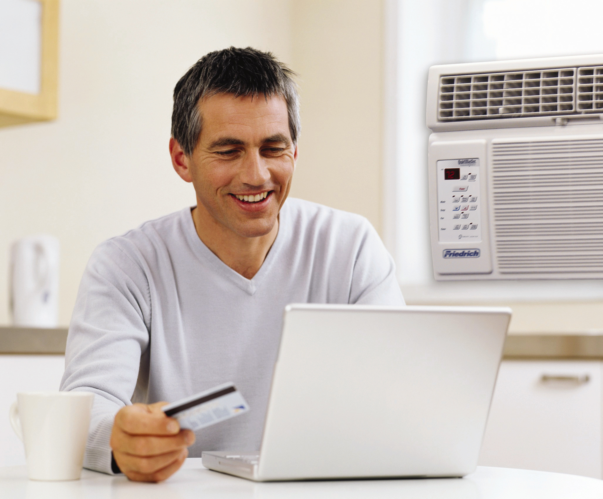 Man Paying Bill Online with Credit Card