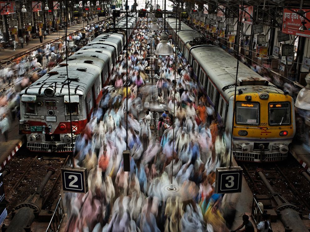 People Crowded between Mumbai Local Trains