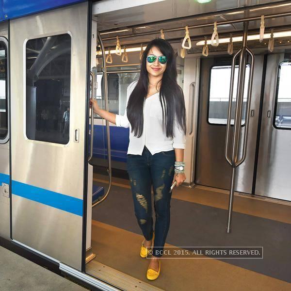 Trisha at doors of chennai Metro train